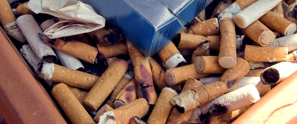 An ashtray with cigarette butts